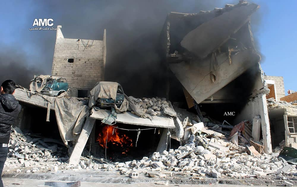 This citizen journalism image provided by Aleppo Media Center, AMC, which has been authenticated based on its contents and other AP reporting, shows a destroyed building after a Syrian aircraft pummeled masaken hanano, an opposition neighborhood in the northern city of Aleppo, Syria.