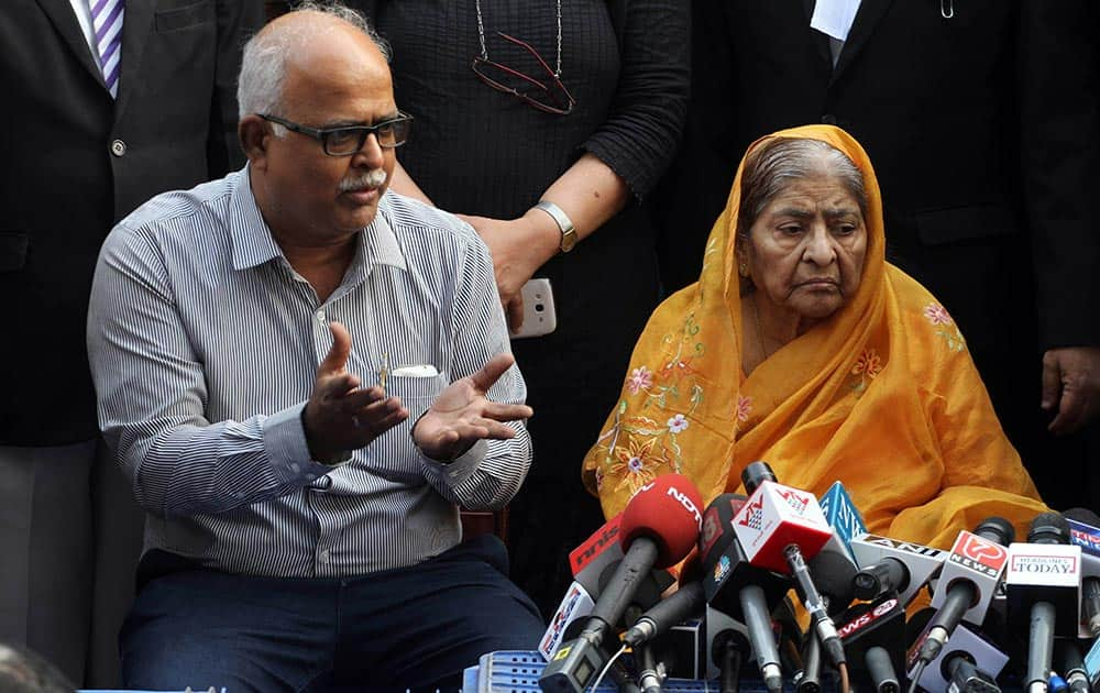 Zakia Jafri listens to her son Tanveer Jafri, son of former Congress lawmaker Ehsan Jafri, after a court ruling rejecting a petition seeking the prosecution of Bharatiya Janata Party leader Narendra Modi in Ahmedabad.