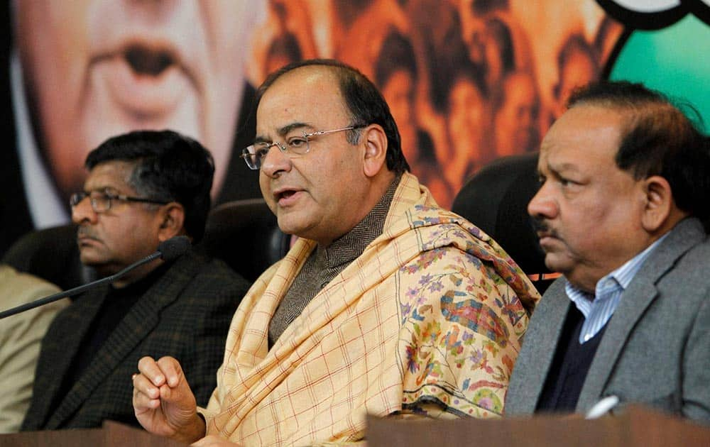 Senior BJP leader Arun Jaitley addresses the media at party headquarters on Thursday after Gujarat Chief Minister Narendra Modi gets clean chit in 2002 Gulbarg society case as metropolitan magistrate rejects Zakia Jafri`s plea against SIT`s clean chit.