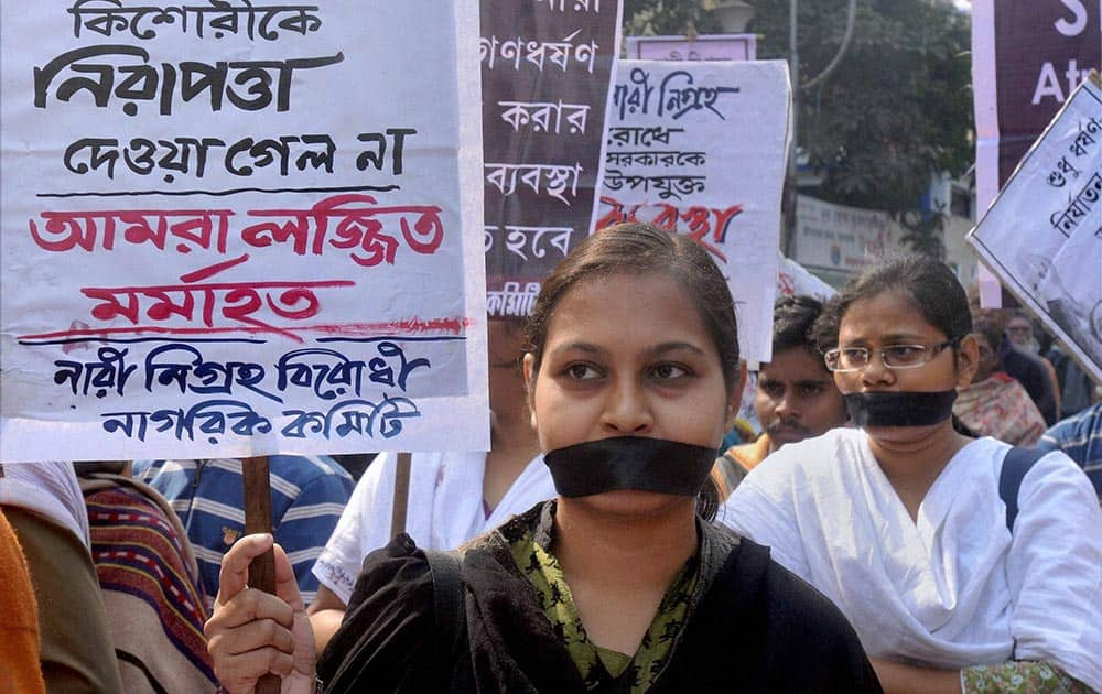 Women wear black ribbons to stage a silent protest against the state governemnt, demanding immediate action against rape and cases of sexual harrassment in Kolkata.