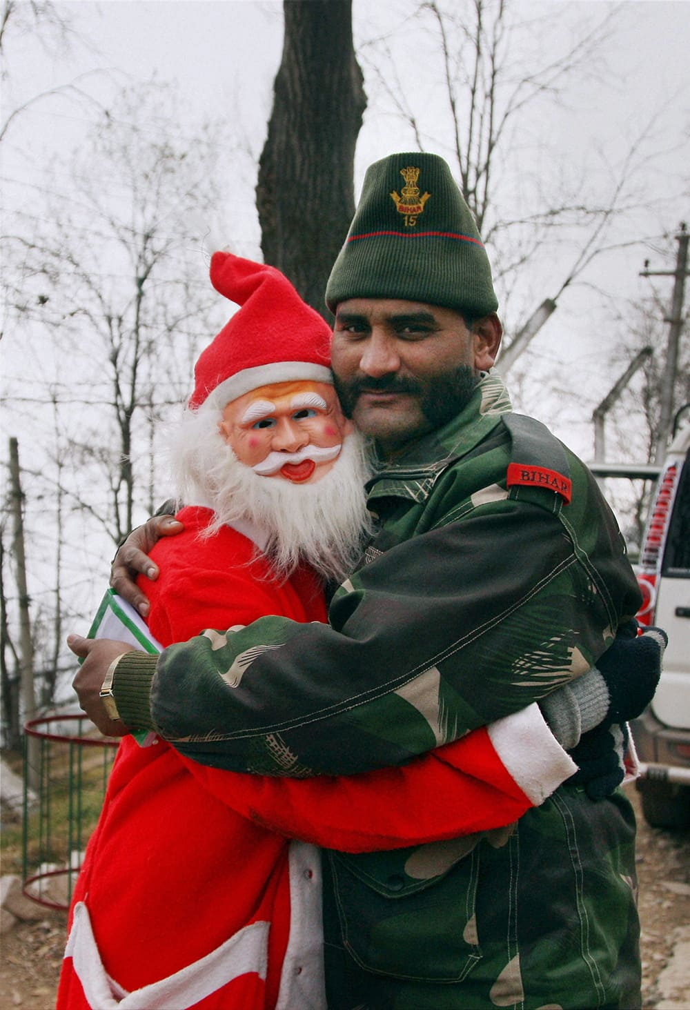 A man dressed as Santa claus greets an army Jawan on the occasion Christma at Bhimber Gali LoC, Poonch district about 250 Km from Jammu.