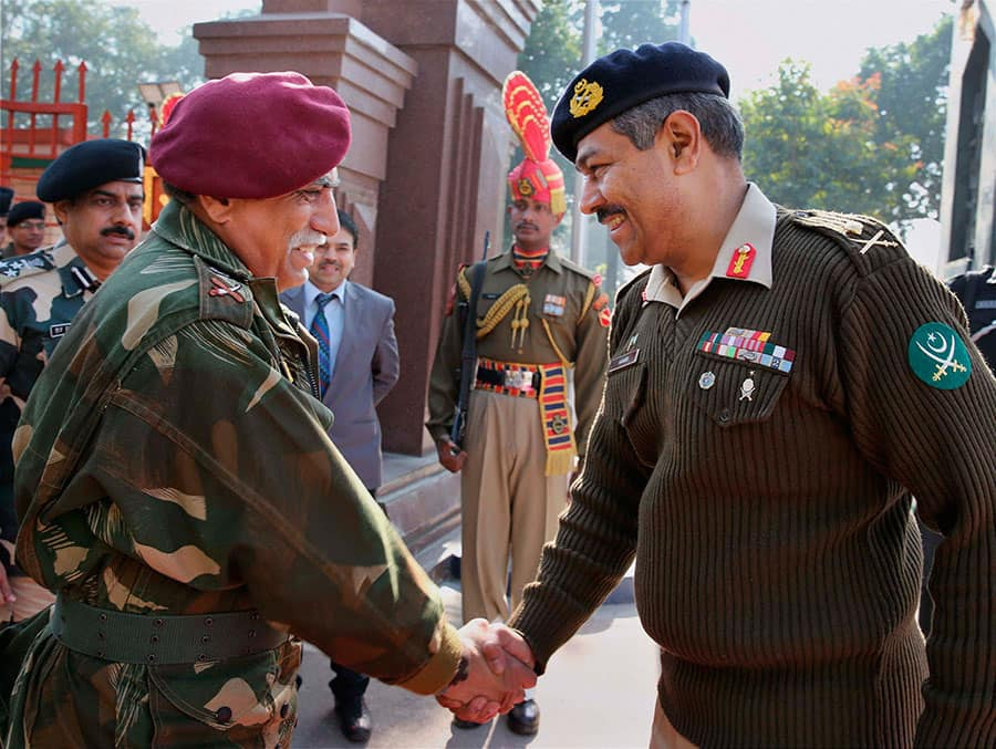 Pakistan Army DGMO Maj Gen Aamer Riaz and Indian Army DGMO Lt Gen Vinodh Bhatia before the delegation level meeting at the Wagah-Attari border.