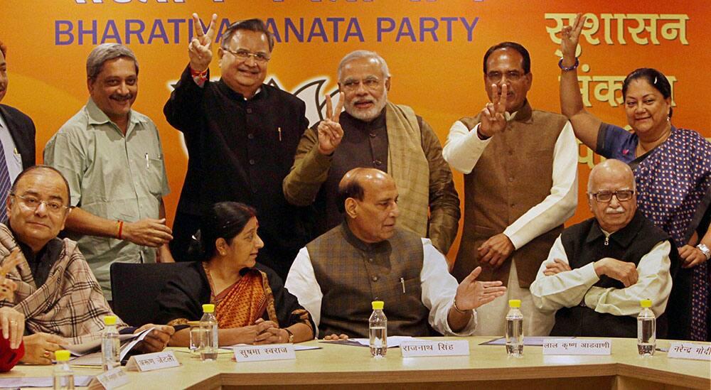 BJP President Rajnath Singh, senior leaders LK Advani, Sushma Swaraj, Arun Jaitley with BJP Chief Ministers Narendra Modi (Gujarat), Shivraj Singh Chouhan (Madhya Pradesh), Vasundhara Raje (Rajasthan), Raman Singh (Chattisgarh), Manohar Parrikar (Goa) during BJP Chief Minister`s conference at party office in New Delhi.