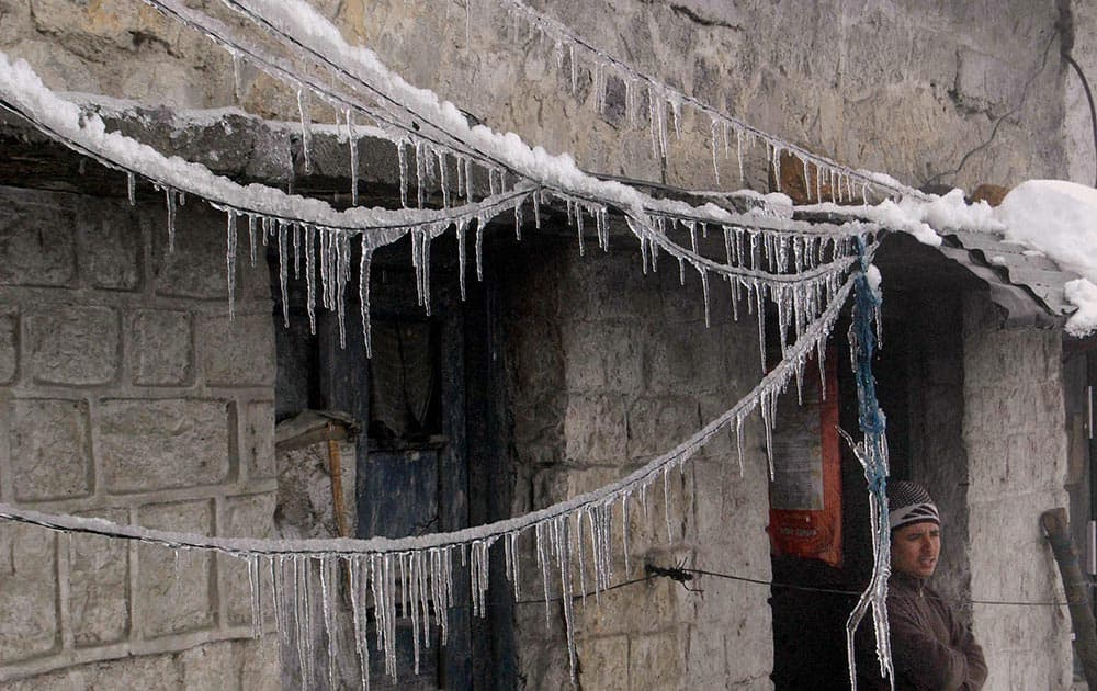 Icicles hang from electric wires after heavy snowfall in Qazigund Anantnag district.