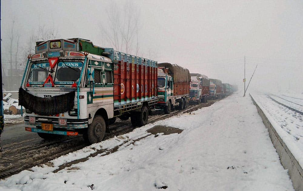 A queue of stranded trucks on the Srinagar-Jammu National Highway, which was closed for vehicular traffic due to heavy snowfall in Qazigund, 69 kms from Srinagar.