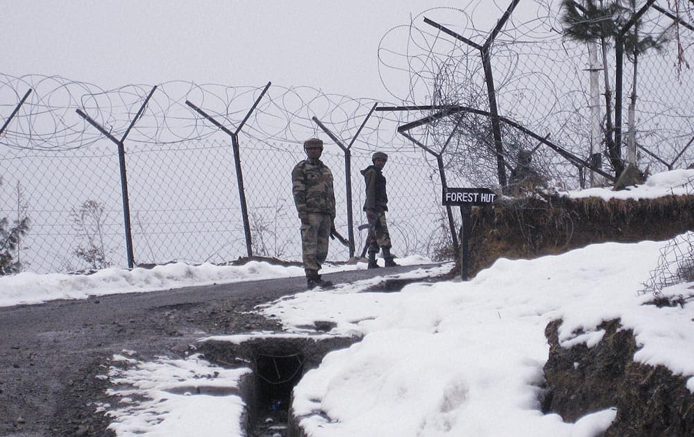 Indian Army jawans patrolling after the first major snowfall of the season in Poonch.