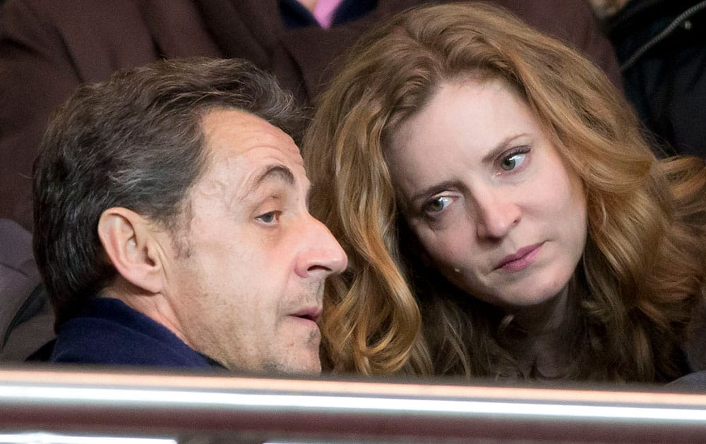 Former French President Nicolas Sarkozy, left, and Nathalie Kosciusko-Morizet, candidate for the upcoming election for the mayor of Paris talk together prior to a French league one soccer match between Paris-Saint-Germain and Lille at Parc des Princes stadium in Paris.
