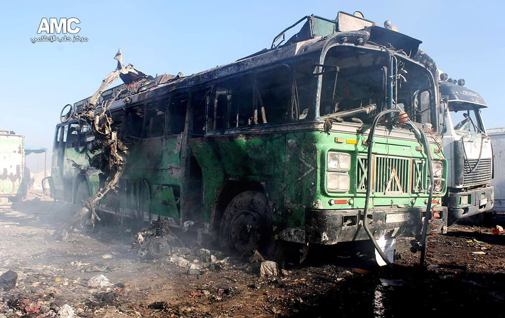 This citizen journalism image provided by Aleppo Media Center, AMC, which has been authenticated based on its contents and other AP reporting, shows damages of a burned bus after a Syrian aircraft pummeled masaken hanano, an opposition neighborhood in the northern city of Aleppo, Syria.