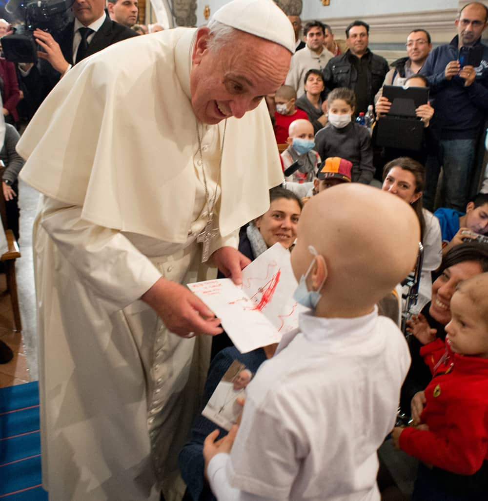 Pope Francis speaks with a child during his visit at the Bambino Gesu` pediatric hospital, in Rome.
