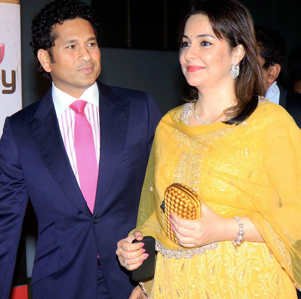 Sachin Tendulkar with wife Anjali during the announcement of CCL4 in Mumbai.