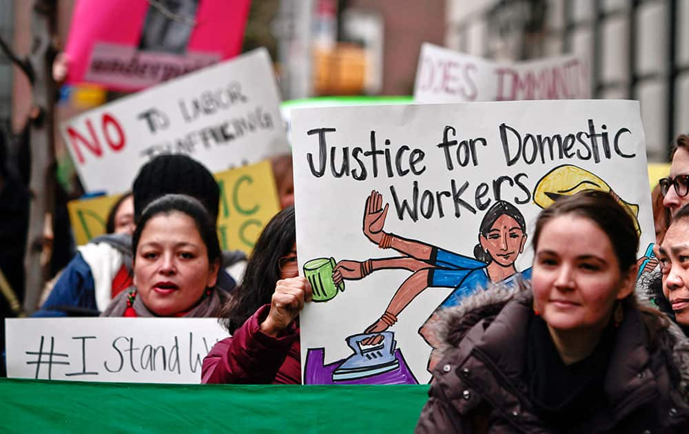 Members and supporters from a coalition of organizations supporting domestic workers, rally outside the Indian consulate, in New York. About two dozen protesters gathered outside the Consulate General of India in New York in support of the housekeeper, carrying signs saying `Justice for domestic workers: hold diplomats accountable` and `Overworked, underpaid.`