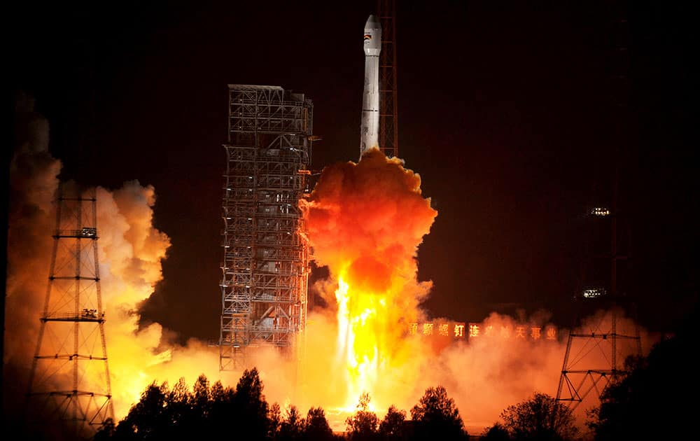 This photo released by China`s Xinhua News Agency, a Bolivian communications satellite is launched from the Xichang Satellite Launch Center(XSLC) in Xichang, southwest China`s Sichuan Province.