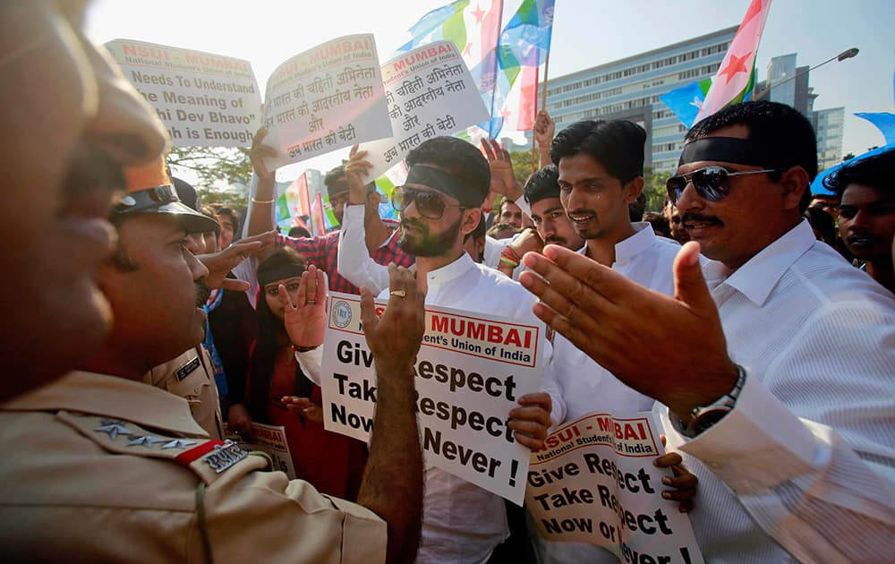 Policemen stop a group of the student wing of ruling Congress party, National Students Union of India (NSUI), during a protest outside the US consulate in Mumbai.