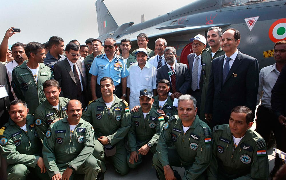 Union Defence Minister A K Antony and Air Chief Marshal N A K Browne with IAF Pilots during initial operational clearance of LCA Tejas for induction into the IAF, in Bengaluru.