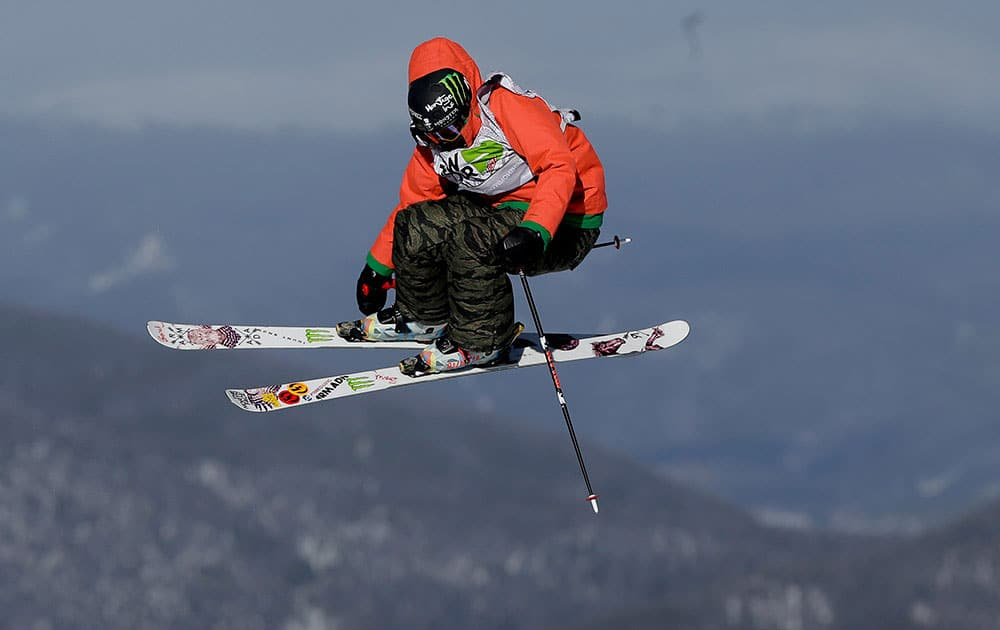 DEVIN LOGAN FLIES OFF A JUMP ON HER FIRST RUN DURING THE SLOPESTYLE FREESTYLE SKIING FINAL AT THE DEW TOUR ION MOUNTAIN CHAMPIONSHIPS, IN BRECKENRIDGE, COLO.