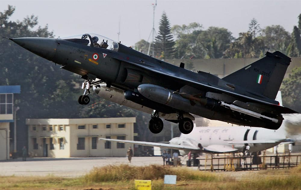 The Light Combat Aircraft, Tejas, takes off during its initial operational clearance for induction into the IAF, in Bengaluru. LCA Tejas received Initial Operational Clearance for Induction into Indian Air Force.
