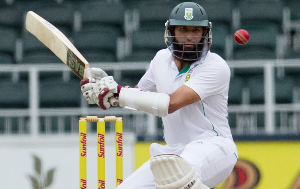Hashim Amla avoids a bouncer from India`s bowler Mohammad Shami during the second day of their cricket test match at Wanderers stadium in Johannesburg, South Africa.