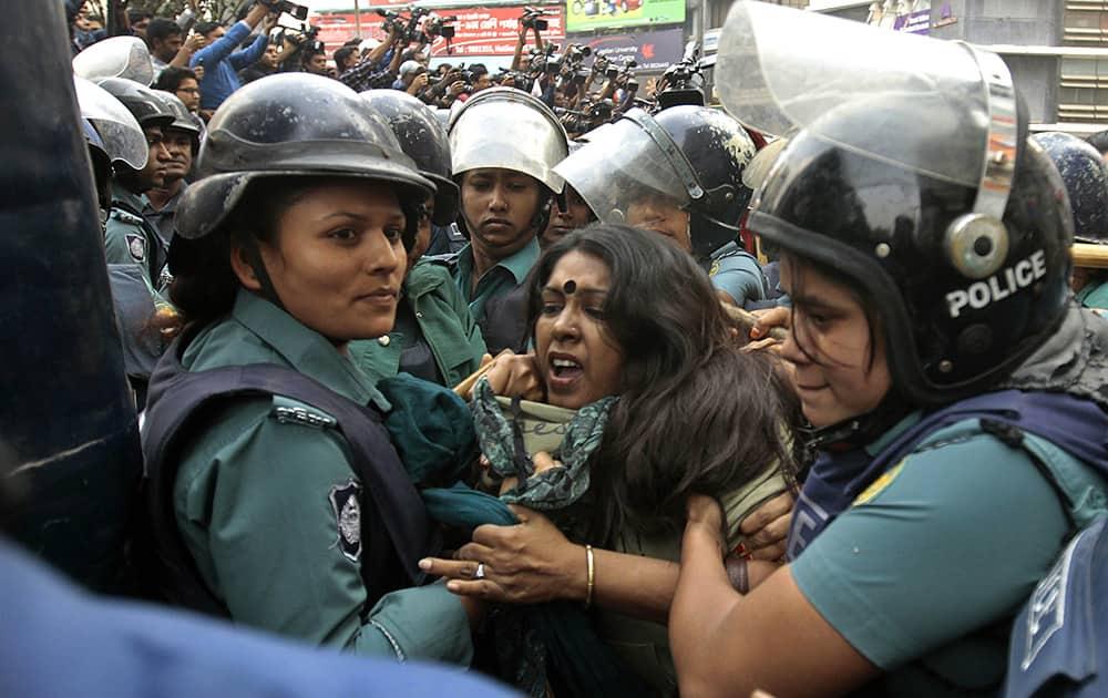 Bangladeshi police detain activists who tried marching towards the Pakistani Embassy in Dhaka, Bangladesh.