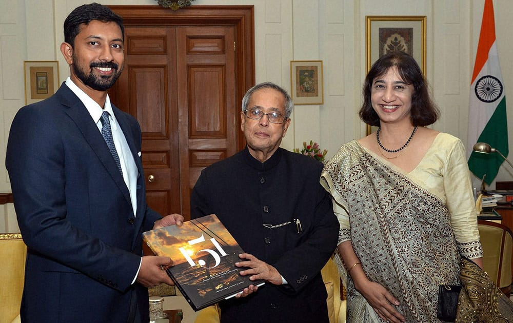 Author Lt. Cdr Abhilash Tomy and co-author Lynn De Souza presenting a copy of the book '151' to the President Pranab Mukherjee at Rashtrapati Bhavan in New Delhi.