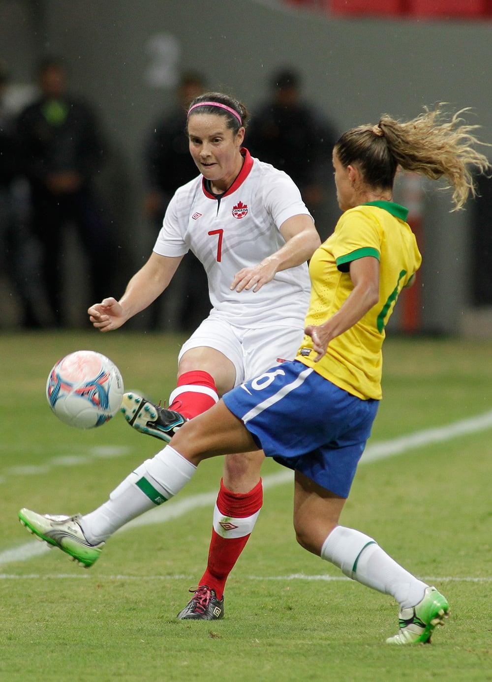 Canada`s Rhian Wilkinson (7) kicks the ball past Brazil's Tamires Cassia, during a soccer match at the International Women`s Football Tournament in Brasilia, Brazil.