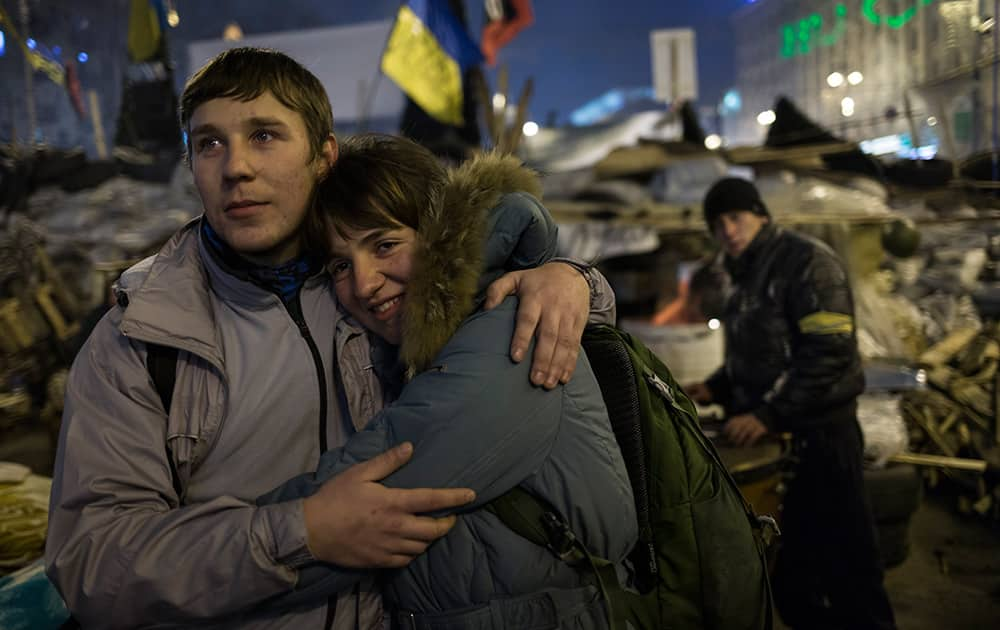 A young couple embrace each other as they look at the stage during a concert after a pro-European Union rally in the Independence Square in Kiev, Ukraine.