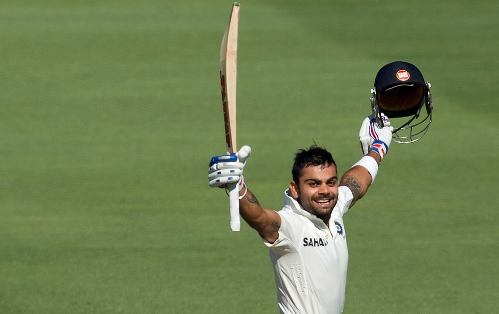 Virat Kohli celebrates his century during the first day of their cricket test match against South Africa at Wanderers stadium in Johannesburg, South Africa.