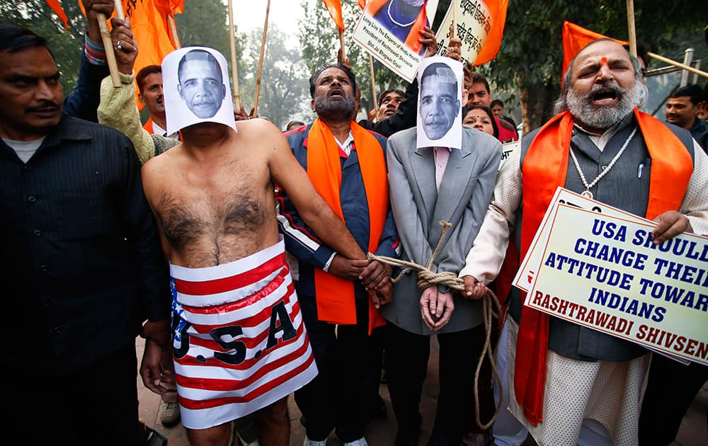 Supporters of Shivsena walk with people representing US President Barack Obama near the US Embassy to protest against the alleged mistreatment of New York based Indian diplomat Devyani Khobragade, in New Delhi.