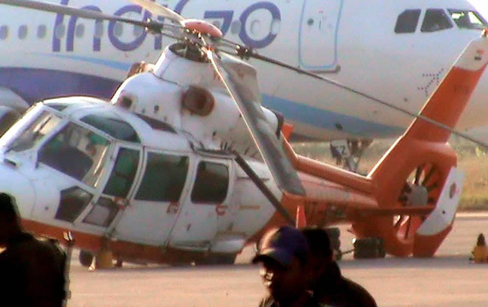 A helicopter after its mishap at Borjhar LGBI air port in Guwahati.