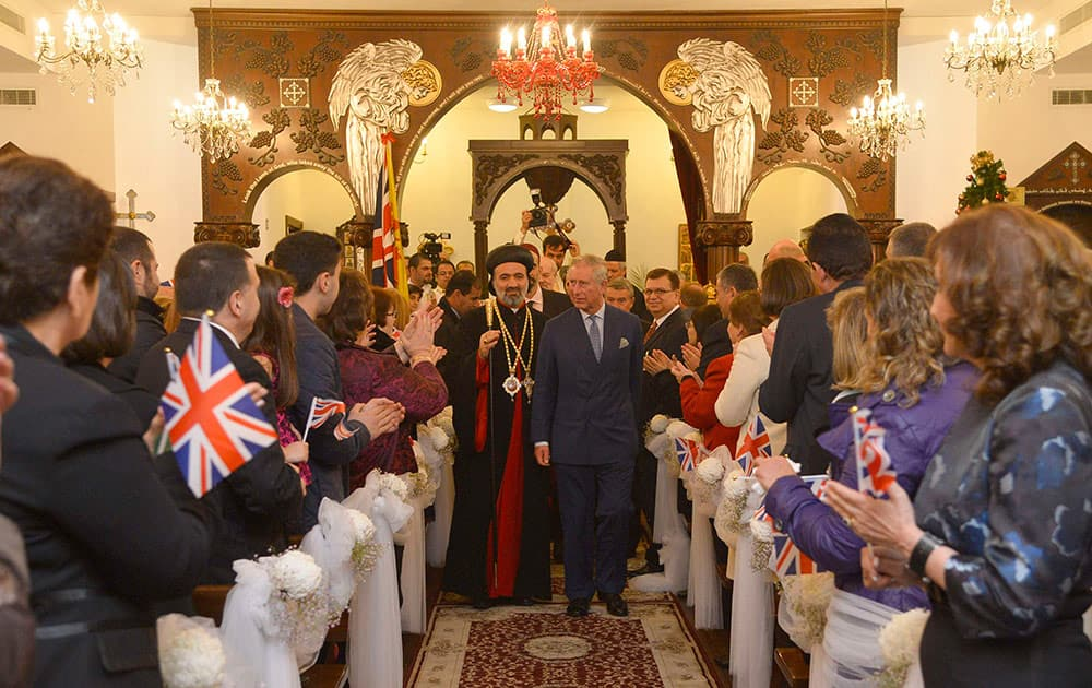 Britain`s Prince Charles, center right, accompanied by the Archbishop of the Syrian Church in the United Kingdom, Archbishop Athanasius, visits a Syriac (Syrian) Orthodox Church in west London.