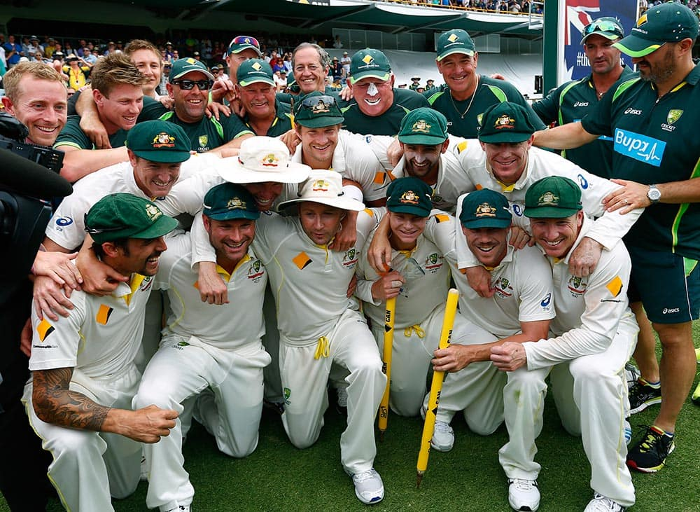 The Australian team poses for group photo after winning their Ashes cricket test match over England, in Perth, Australia. Australia won the match by runs and take an unbeatable 3-0 lead in the five game series.