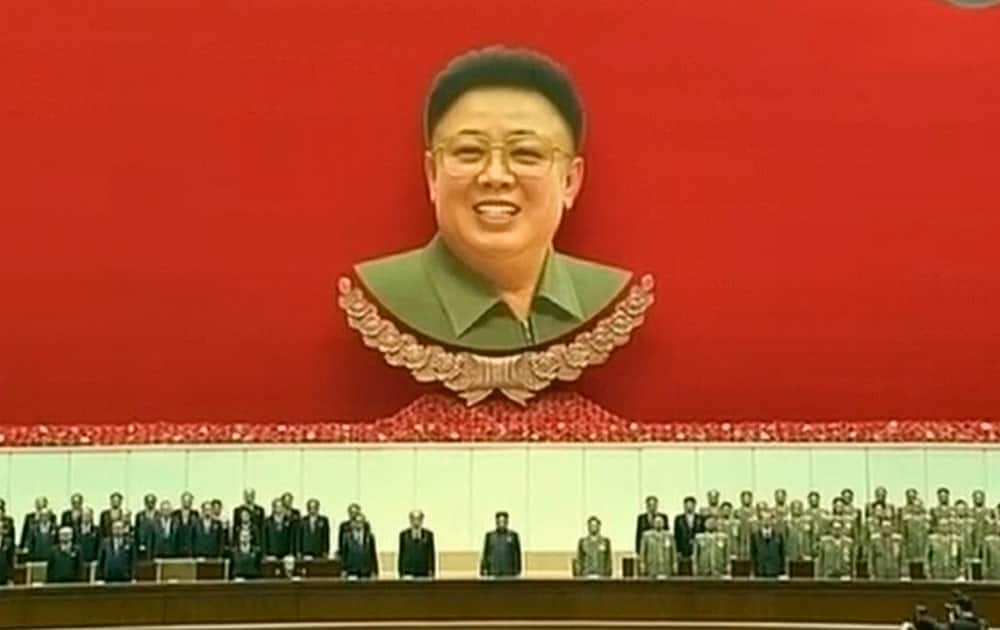 North Korean leader Kim Jong Un, center, attends an event to mark the second anniversary of the death of his father, former leader Kim Jong Il, in Pyongyang, North Korea.