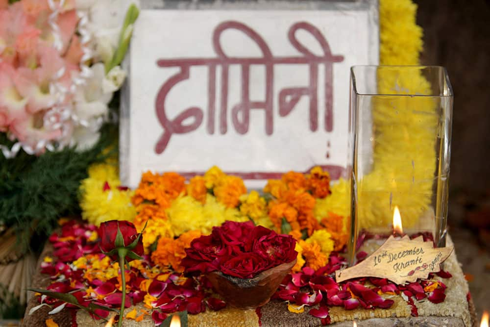 "Flowers and candles are placed near a placard reading: ""Damini"", a symbolic name given to a gang-raped victim, in New Delhi."