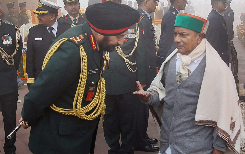Defence Minister A K Antony sharing a word with Army Chief Gen Bikram Singh after paying homage to the martyrs at Amar Jawan Jyoti at India to mark the `Vijay Divas` in New Delhi.