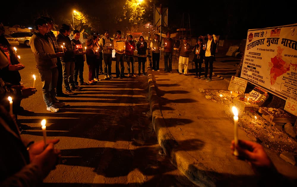 Indians hold candles as they commemorate last year's gang rape and murder of a young woman in New Delhi.