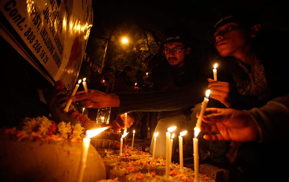 Indians light candles as they commemorate last year's gang rape and murder of a young woman in New Delhi.