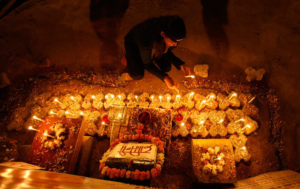 An Indian girl places candles to commemorate last year's gang rape and murder of a young woman in New Delhi.