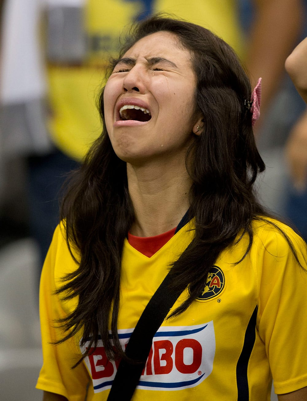 A fan of America cries at the end of the match against Leon during the final of the Mexican soccer league championship in Mexico City.