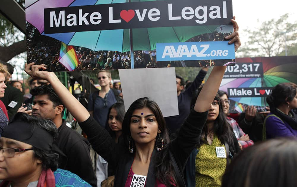 Gay rights activists hold placards during a protest against a Supreme Court verdict that upheld section 377 of the Indian Penal Code that criminalizes homosexuality in New Delhi.