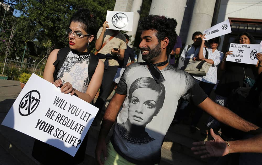 Gay rights activists hold placards as they participate in a protest against a Supreme Court verdict that upheld section 377 of the Indian Penal Code that criminalizes gay sex, in Bangalore.