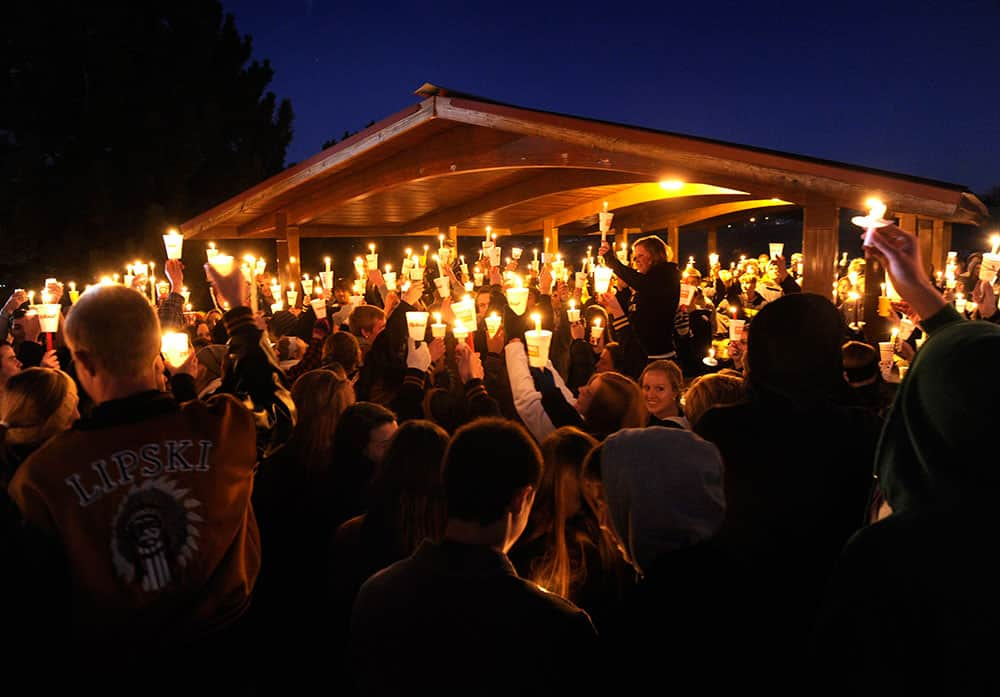 Hundreds of Arapahoe High School students gathered for a candlelight vigil Saturday night, to share their prayers for Claire Davis who was shot inside the school.