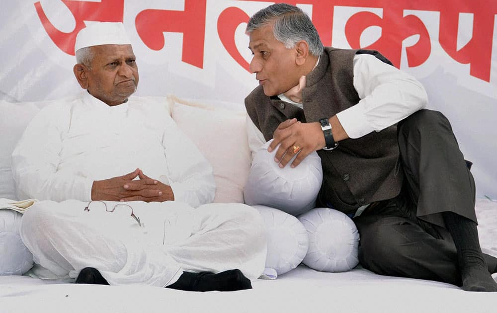 Former Army Chief General V K Singh with social activist Anna Hazare during fourth day of the latter`s indefinite hunger strike, at his Ralegan Siddhi village in Ahmednagar.