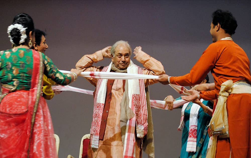Pandit Birju Maharaj being presented 75 Assamese japis on his 75th birthday during a function in Guwahati.