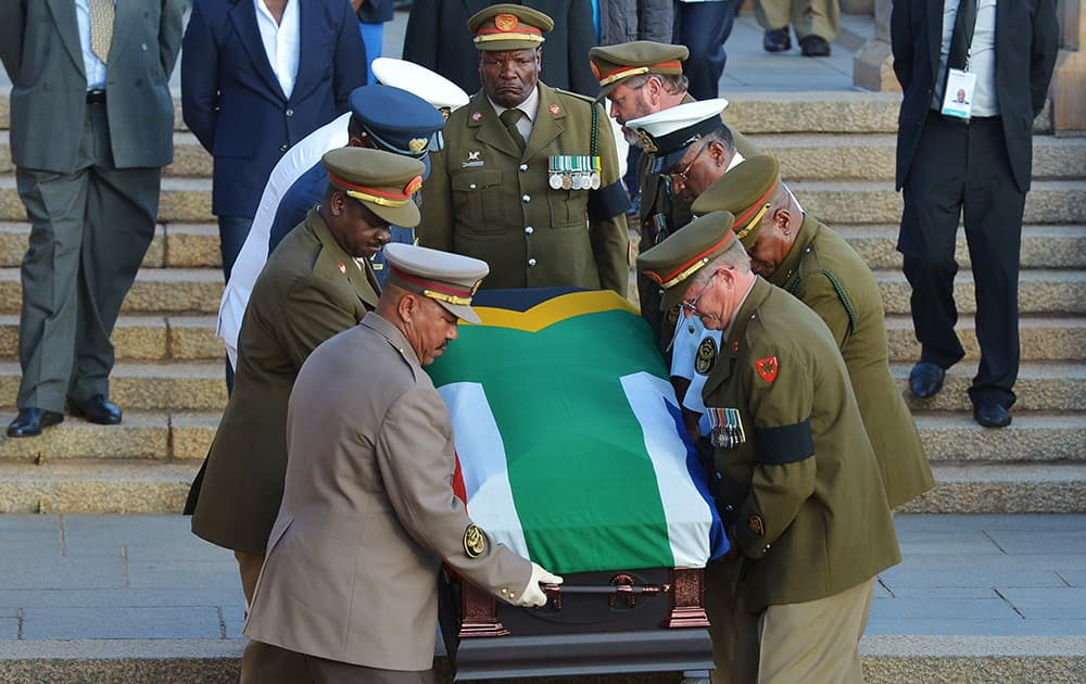 The national flag draped coffin of former South African President Nelson Mandela is carried down steps of the Union Buildings at the end of the third and final day of lying in state in Pretoria, South Africa.