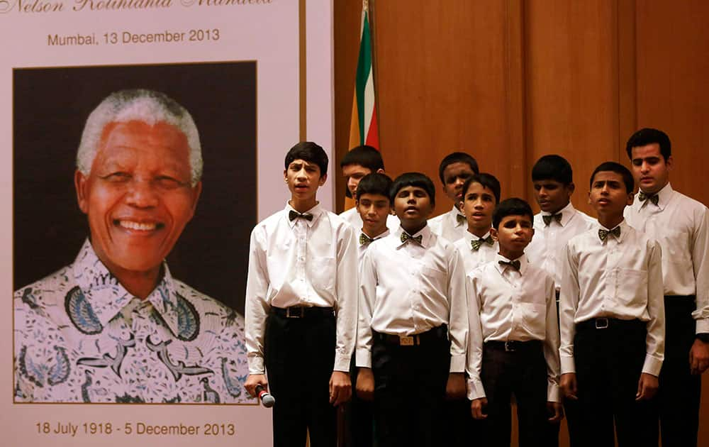 Visually impaired children of the Happy Home School sing a song during a memorial service for late former South African President Nelson Mandela in Mumbai.