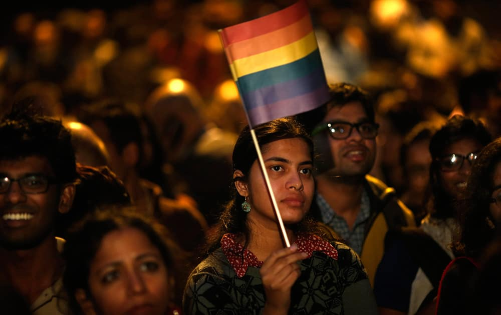 Gay rights activists attend a protest meeting after the top Indian court ruled that a colonial-era law criminalizing homosexuality will remain in effect in India in New Delhi.