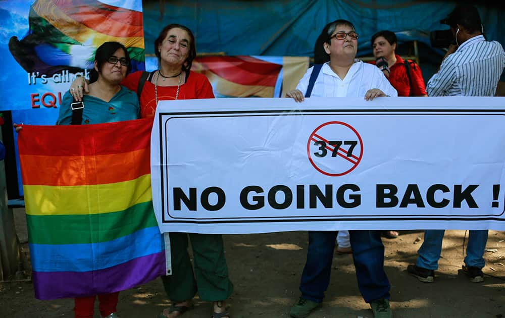 A group of Indian activists hold a banner against section 377 of the Indian Penal Code that criminalizes homosexuality during a protest in Mumbai.