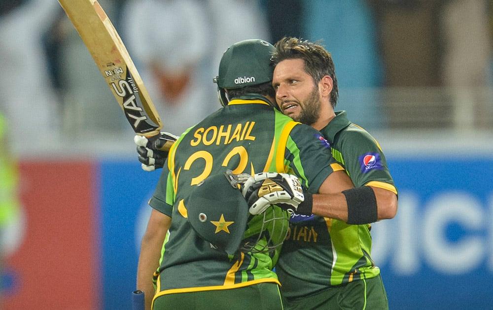Pakistan`s batsman Shahid Afridi, celebrates with Sohail Tanvir the victory of the match, during the first T20 cricket match between Pakistan and Sri Lanka, at the DSC Cricket Stadium Dubai
