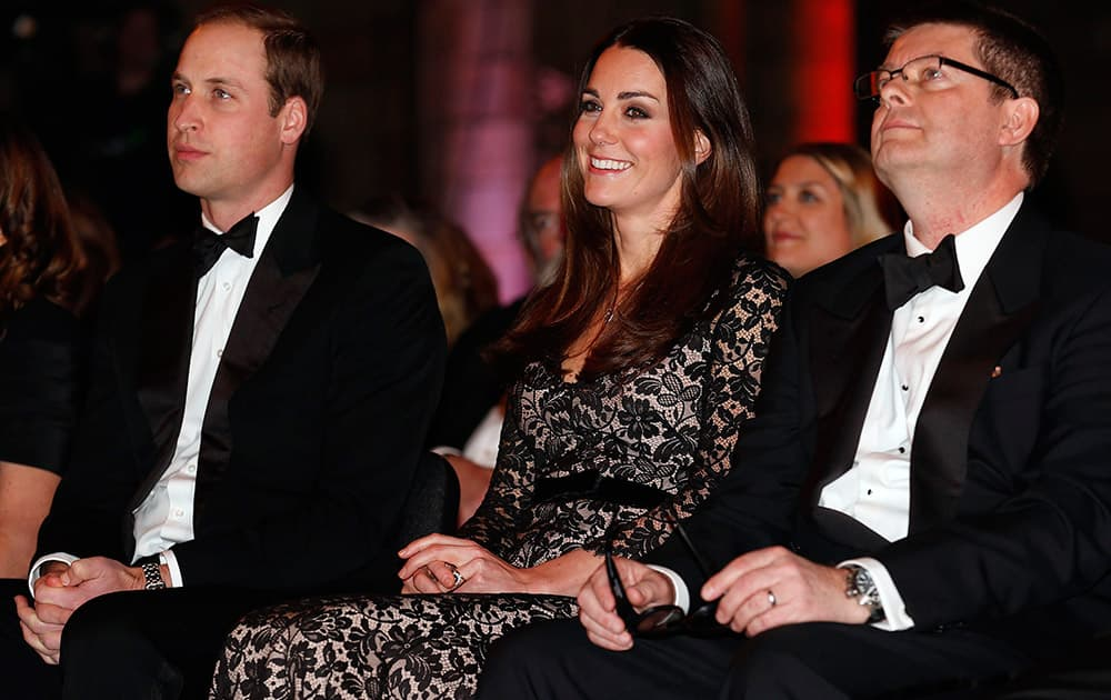 From left, Britain`s Prince William, the Duke of Cambridge, and his wife Kate, the Duchess of Cambridge, sit with Natural History Museum Director Michael Dixon, before a screening of ` David Attenborough`s Natural History Museum Alive 3D` , at the Natural History Museum, in London.