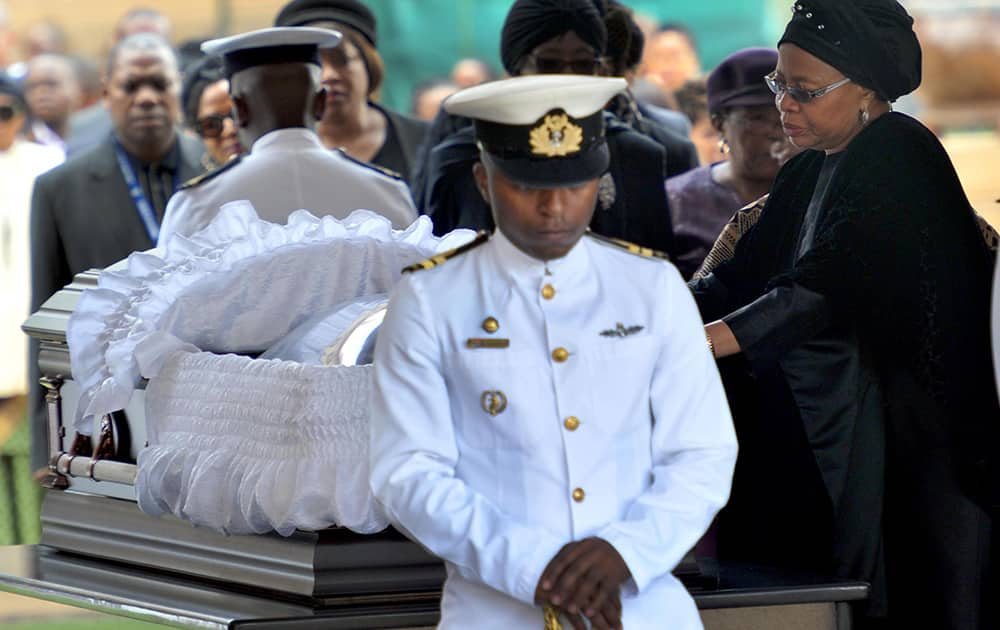Nelson Mandela`s widow Graca Machel pays her respects to former South African President Nelson Mandela during the lying in state at the Union Buildings in Pretoria, South Africa.