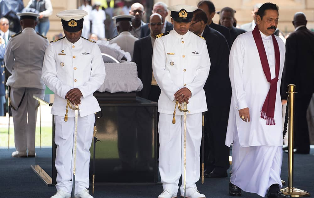 Sri Lanka`s President Mahinda Rajapaksa leaves after paying his respects to former South African President Nelson Mandela during the lying in state at the Union Buildings in Pretoria, South Africa.